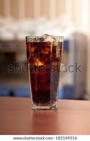 glass of cola with ice on the bar - stock photo