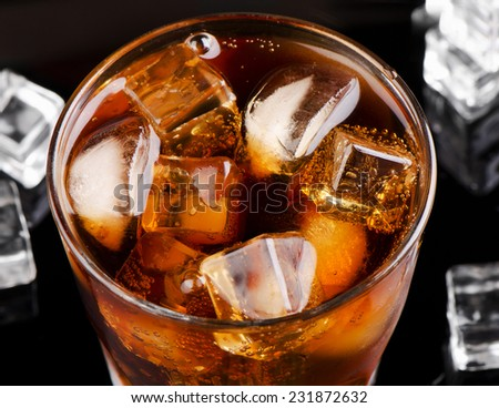 Glass of cola with ice . Selective focus