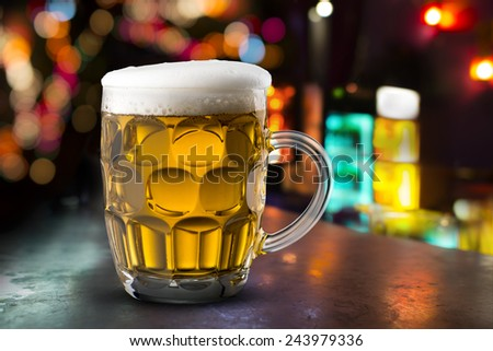 Glass of Cold Beer In Pub - stock photo