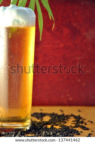 Glass of cold beer with drops of water due to the freezing of the drink - stock photo