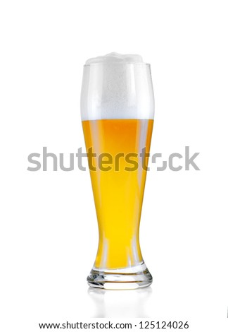 Glass of cold beer with froth isolated on white