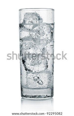 Glass of cold beverage with a lot of ice - stock photo