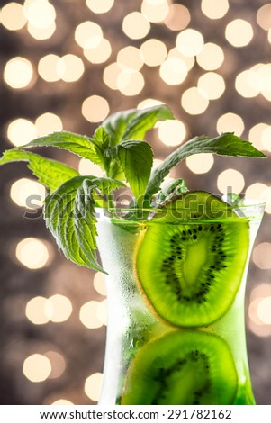 Glass of cold kiwi drink