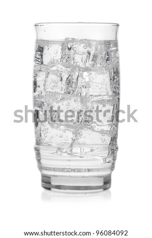 Glass of cold mineral water with ice cubes on white background - stock photo