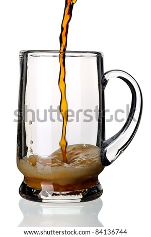 Glass of dark beer, isolated on a white background.
