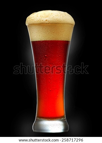 glass of dark beer isolated on black background - stock photo