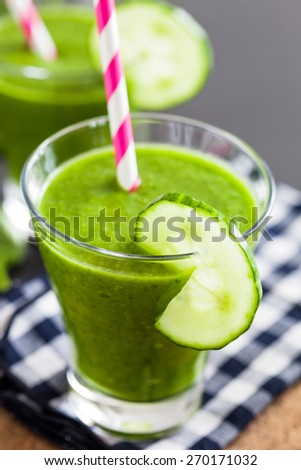 Glass of fresh and healthy green smoothie - stock photo