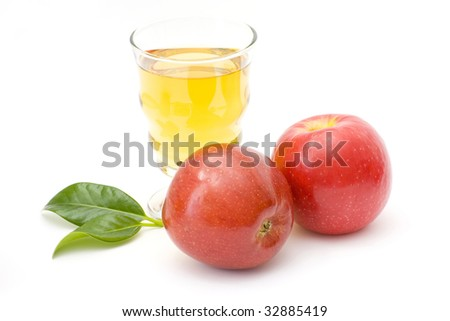 glass of fresh apple juice and fresh fruits