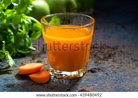 glass of fresh carrot juice, closeup - stock photo
