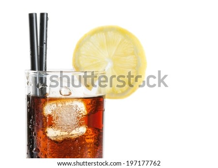 glass of fresh coke with straw with lemon slice on top and white background with space for text, summer time - stock photo