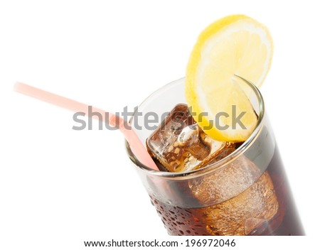 glass of fresh cola with straw with lemon slice on top and white background, summer time