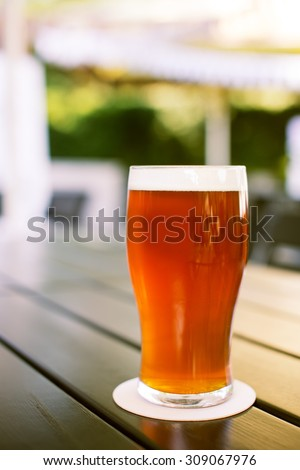 Glass of fresh craft ale beer. American Pale Ale hoppy beer. - stock photo