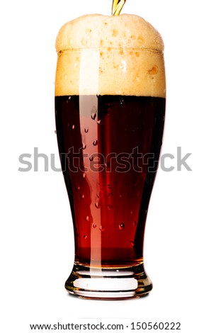 glass of fresh dark beer cut out from white - stock photo
