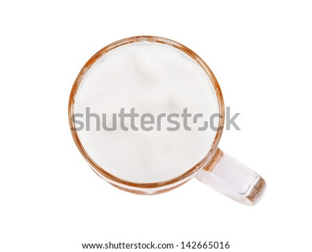 glass of fresh lager beer on white table - stock photo