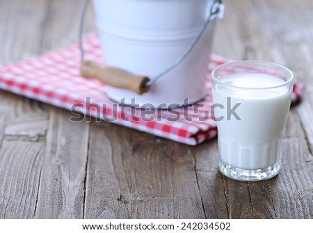Glass of fresh milk on wooden table in the kitchen.  - stock photo
