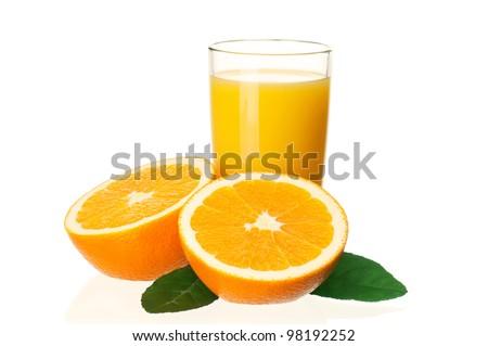 Glass of fresh orange juice and orange fruits with green leaves on white background - stock photo