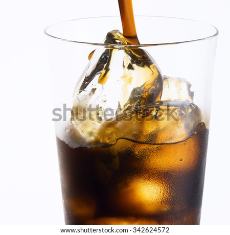 Glass of fresh soda with ice - stock photo