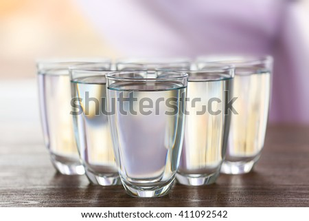 Glass of fresh water on wooden table - stock photo