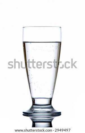 Glass of fresh water reflected on white background - stock photo