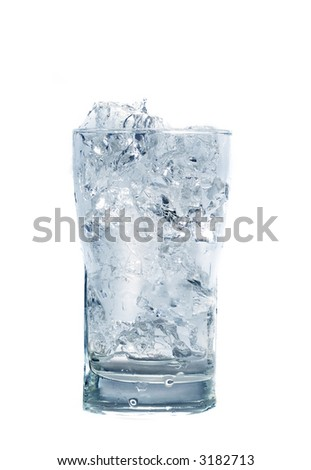 Glass of fresh water with cubes of ice - stock photo