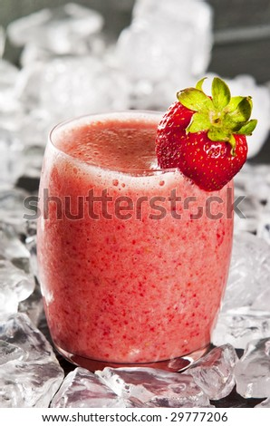 glass of freshly made strawberry smoothie - stock photo