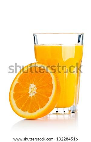 Glass of freshly pressed orange juice with sliced orange half over white background - stock photo