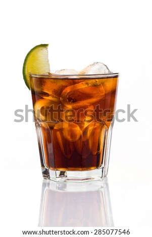 Glass of frozen cocktail with cola on white background