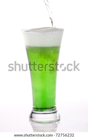 Glass of green beer for St Patrick's Day - stock photo