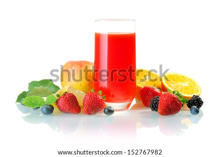 Glass of healthy blended fresh fruit juice cocktail surrounded by fresh apple, oranges and berries including strawberry, blackcurrant and blueberry - stock photo