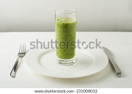 Glass of Healthy green smoothie with vegetables - stock photo