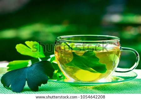 Glass of Herbaceous Tea with Ginkgo Leaves