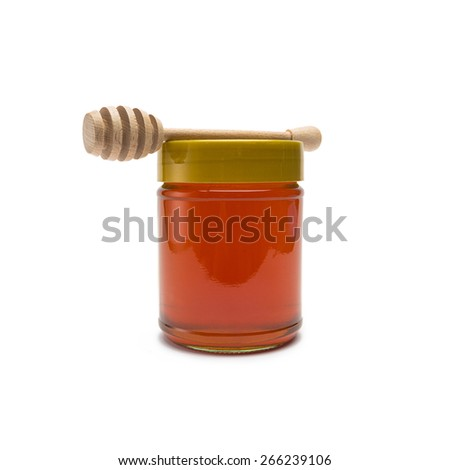 glass of honey with wooden drizzler from the supermarket on white background - stock photo