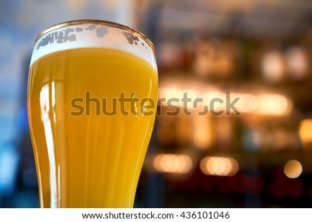 Glass of ice cold beer with beautiful background lighting