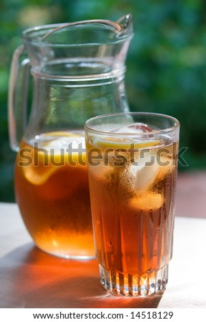 Glass of ice tea and pitcher