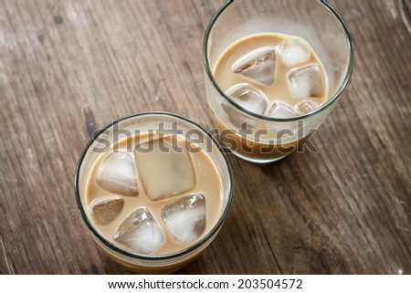 glass of iced coffee on wood - stock photo
