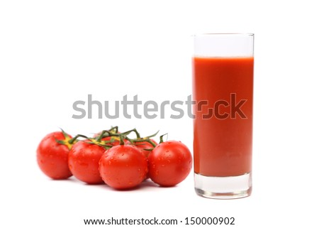 glass of juice and tomatoes