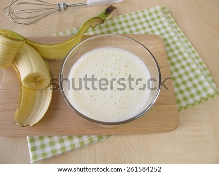 Glass of kefir with banana - stock photo