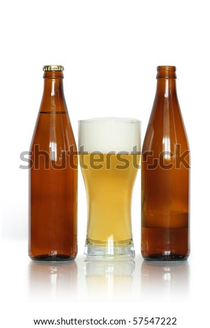Glass of lager beer near two bottles isolated on white background with clipping path