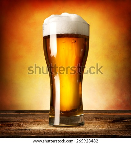 Glass of lager on a wooden table  - stock photo