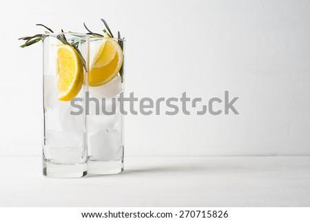 Glass of lemon drink with lemon slice - stock photo