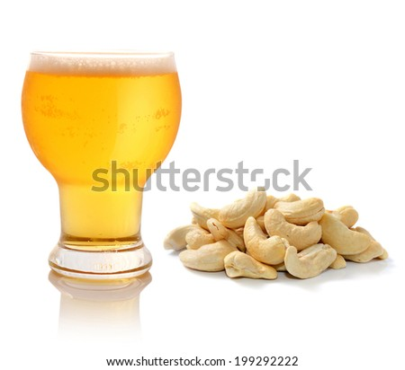 Glass of light beer and cashew nuts  isolated on white - stock photo