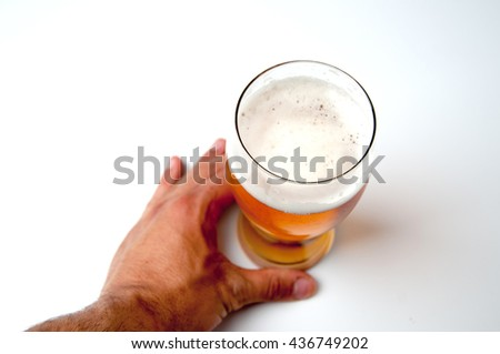 Glass of light beer and male hand , isolated on a white background