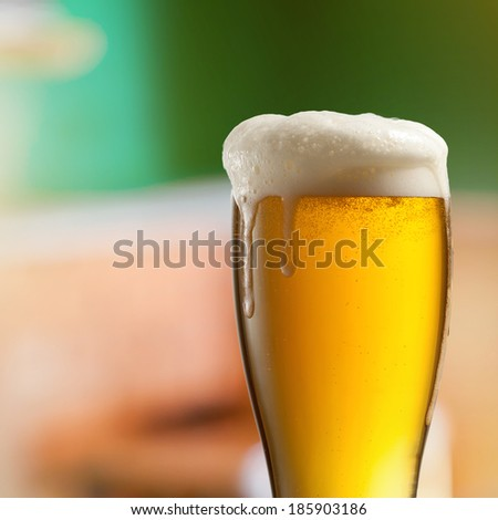 Glass of light beer in pub - stock photo