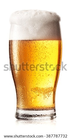 Glass of light beer with foam and drops on the glass