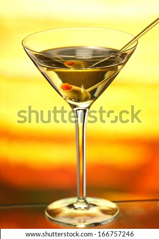 Glass of martini drink with olive