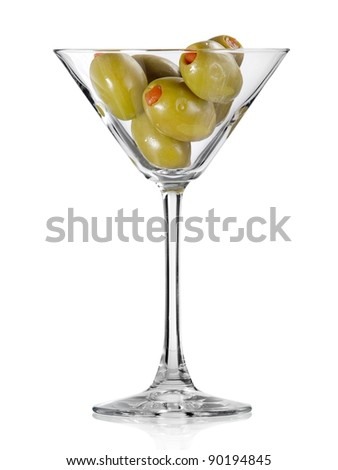 Glass of martini full with green olives