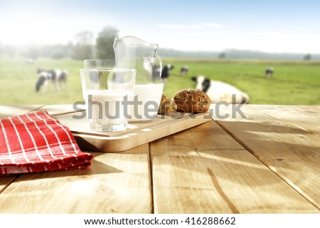 glass of milk and cows  - stock photo