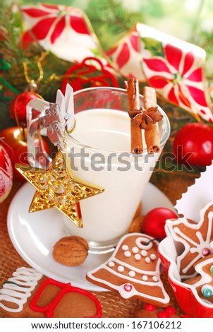 glass of milk and gingerbread cookies waiting for santa claus