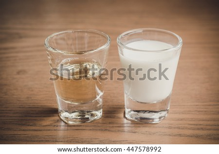 glass of milk and syrup - stock photo