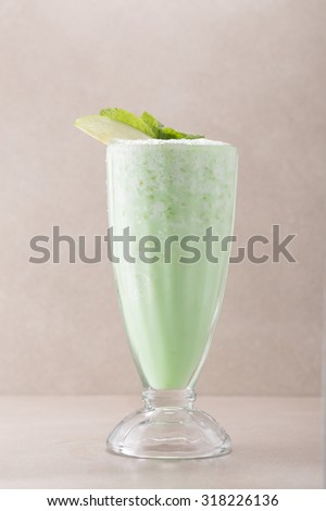 Glass of milkshake isolated on grey background - stock photo